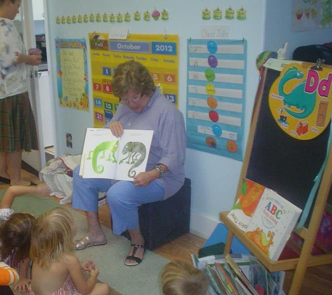 "Volunteer reading pal Mary Ellen Large reads the book ""Mixed up Chameleon"" to her preschool class at Sea Side School in St. Augustine."