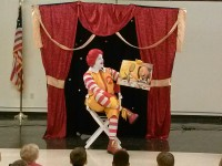 Ronald McDonald reads to children during ELC's Reading with Ronald Event.