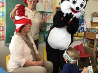 Dr. Seuss' Cat in the Hat Reads to Children in local childcare center.
