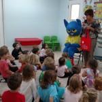 Pete the Cat and Joan Whitson, ELC of North Florida Early Literacy Outreach Manager, read books from the book bag project to hildren at Seaside School in St. Augustine.