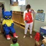 Special guest Pete the Cat and Joan Whitson, ELC of North Florida Outreach Manager, read books from the book bag project to the children at Miss Kate's Preschool in Fernandina Beach.