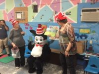 "ELC of North Florida volunteers Sally Leitzman and Sara Pines read with special guest ""The Cat in the Hat"" to children at The Children's Academy of Interlachen."