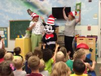 "ELC volunteers Cathy Voss, Teresa Widman and special guest ""The Cat in the Hat"" enjoy story time at KidsFirst Learning Center in Middleburg."